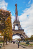 Eiffel tower surrounded by tourists Stock Photos