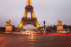 Eiffel tower surroundings  in evening fog. Royalty Free Stock Photography