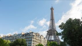 Eiffel Tower Timelapse Video over the building. Eiffel Tower timelapse video from nearby residential area stock video footage