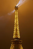 Eiffel tower top part in Paris at night Stock Image