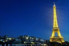 The Eiffel Tower Tour Eiffel lit up against a dark blue sky. stock photos