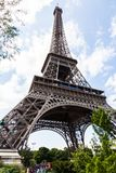 The Eiffel Tower with tourists lining up for tickets. A shot of the height of the Eiffel Tower from below, looking up towards the sky. You can see a line of Royalty Free Stock Photography