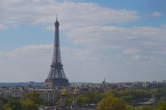 The Eiffel Tower towering over the city of Paris Royalty Free Stock Photography