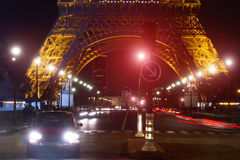 Eiffel Tower Traffic Night. Place: Paris. Date: November 7, 2014. Touristic spot and landmark in Paris, France: a street near the Eiffel tower Tour de Eiffel by Royalty Free Stock Images