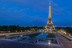 The Eiffel Tower Trocadero Fountain Paris Night. The Eiffel Tower steel structure at night in Paris, France and the fountain of Trocadero palace at the first Stock Image