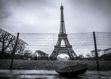 Eiffel tower and umbrella on a rainy day. Eiffel tower from Paris, France and a black umbrella, in black and white settings, on a rainy day Stock Photo
