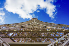 Eiffel tower under clouds and blue sky. View of the Eiffel tower under clouds and blue sky Royalty Free Stock Photos