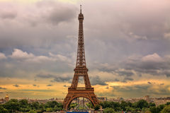 Eiffel Tower under cloudy sky. Paris, France. Stock Images