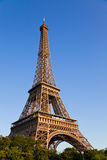 Eiffel tower under last rays of sun. Royalty Free Stock Photos