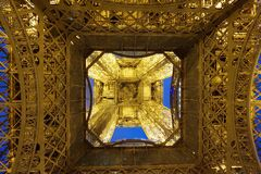 The Eiffel Tower from underneath. Underneath the Eiffel Tower at night Stock Image