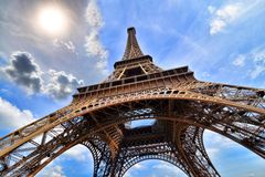 Eiffel Tower upward view with sun, Paris Stock Photography