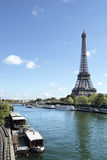 Eiffel Tower vertical landscape, river seine and boats, copy space, vertical Stock Photo