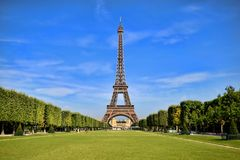 Eiffel Tower with vibrant blue sky. Eiffel Tower, iconic Paris landmark with vibrant blue sky Royalty Free Stock Images