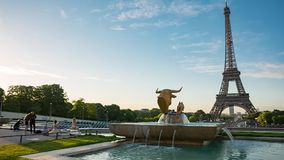 Eiffel Tower video from Trocadero Place. PARIS, FRANCE - JUNE 10, 2017: Eiffel Tower video from Trocadero Place on sunrise with fountains on foreground. Left to stock video footage
