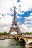 Eiffel Tower. View at the Eiffel tower with a bridge from another riverbank Royalty Free Stock Photography
