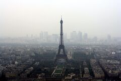 Eiffel Tower View in Foggy Weather Stock Photos