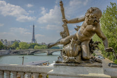 Eiffel Tower view and a statue from Pont Alexandre III Royalty Free Stock Photography