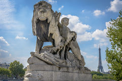Eiffel Tower view and a statue from Pont Alexandre III Royalty Free Stock Photos