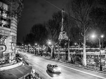Eiffel tower view and street. At night, monochrome Stock Photos