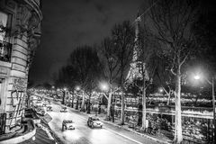 Eiffel tower view and street. At night, monochrome Stock Image