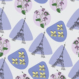 Eiffel tower, violet and Royal lilies. Royalty Free Stock Image