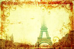 Eiffel Tower in winter on grunge background. Eiffel Tower with top hiding in clouds view from Champs-de-Mars, winter, Paris, France on grunge background designed Royalty Free Stock Photo