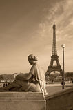 Eiffel tower with a woman's sculpture Royalty Free Stock Photo