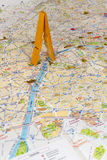 Eiffel tower. Wooden clamp as Eiffel tower on a map. Conceptual photography Royalty Free Stock Image