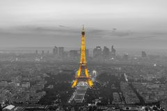 Cityscape of paris in the dusk with eiffel tower. The Eiffel Tower is a wrought iron lattice tower on the Champ de Mars in Paris, France. It is named after the Stock Photography