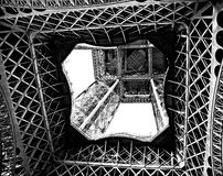 Eiffel Up. Looking up through the middle lattice of the Eiffel Tower Royalty Free Stock Images