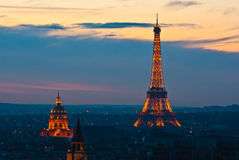 Eiffel tower lit in the evening Stock Photos