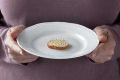 Eigengemaakte roosteren-pompoensoep in een witte kom. Royalty-vrije Stock Foto