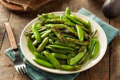 Eigengemaakte Sauteed Sugar Snap Peas Stock Foto's