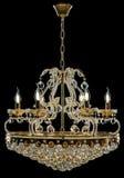Eigentijdse gouden die kroonluchter op zwarte achtergrond wordt geïsoleerd Crystal Chandelier royalty-vrije stock foto