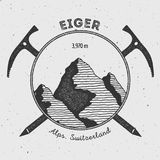 Eiger in Alps, Switzerland outdoor adventure logo. Climbing mountain vector insignia. Climbing, trekking, hiking, mountaineering and other extreme activities Royalty Free Stock Photos