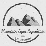 Eiger in Alps, Switzerland outdoor adventure logo. Round trekking vector insignia. Climbing, trekking, hiking, mountaineering and other extreme activities logo Stock Photo