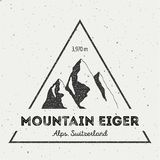 Eiger in Alps, Switzerland outdoor adventure logo. Triangular mountain vector insignia. Climbing, trekking, hiking, mountaineering and other extreme activities Stock Photography