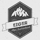 Eiger in Alps, Switzerland outdoor adventure logo. Pennant expedition vector insignia. Climbing, trekking, hiking, mountaineering and other extreme activities Stock Photography