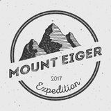 Eiger in Alps, Switzerland outdoor adventure logo. Round expedition vector insignia. Climbing, trekking, hiking, mountaineering and other extreme activities Royalty Free Stock Image