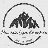 Eiger in Alps, Switzerland outdoor adventure logo. Round hiking vector insignia. Climbing, trekking, hiking, mountaineering and other extreme activities logo Royalty Free Stock Image