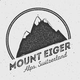 Eiger in Alps, Switzerland outdoor adventure logo. Round mountain vector insignia. Climbing, trekking, hiking, mountaineering and other extreme activities logo Stock Images