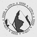 Eiger in Alps, Switzerland outdoor adventure logo. Round stamp vector insignia. Climbing, trekking, hiking, mountaineering and other extreme activities logo Royalty Free Stock Photo