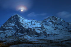Eiger and Moench at night, Switzerland. Eiger, Moench and Jungfrau are a chain of legendary mountains in the Bernese Alps in Switzerland. Jungfrau peak (4158m/ stock images