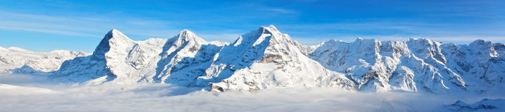 Eiger, Monch and Jungfrau massif. Panoramic view of Eiger, Monch and Jungfrau massif, Swiss Alps, Switzerland, Europe Stock Photo