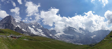 Eiger, Monch and Jungfrau mountains in Jungfrau region Stock Image