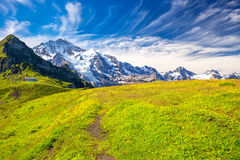 Eiger, Monch and Jungfrau peaks from Mannlichen in Swiss Alps Stock Photo