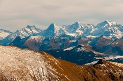 Peaks of Eiger, Monch and Jungfrau seen from Kaiseregg Peak, Swiss Alps and Prealps. Eiger, Monch and Jungfrau peaks seen from Kaiseregg Peak, Swiss Alps and royalty free stock images