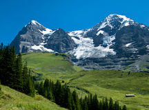 Eiger and Monch landscape. Panorama with Eiger mountain (3970 m) and Monch mountain, Switzerland Alps royalty free stock photography