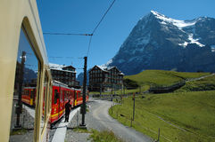 Eiger mountain and train in Kleine Scheidegg in Switzerland Royalty Free Stock Photography