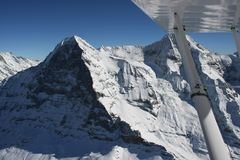 Eiger North Face. Winter in the Swiss high alps, flying in front of the famous Eiger North Face royalty free stock image